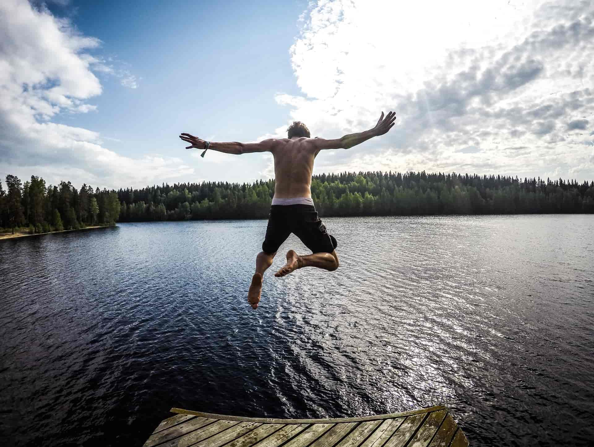 man jumping into lake. 30 days wild ideas