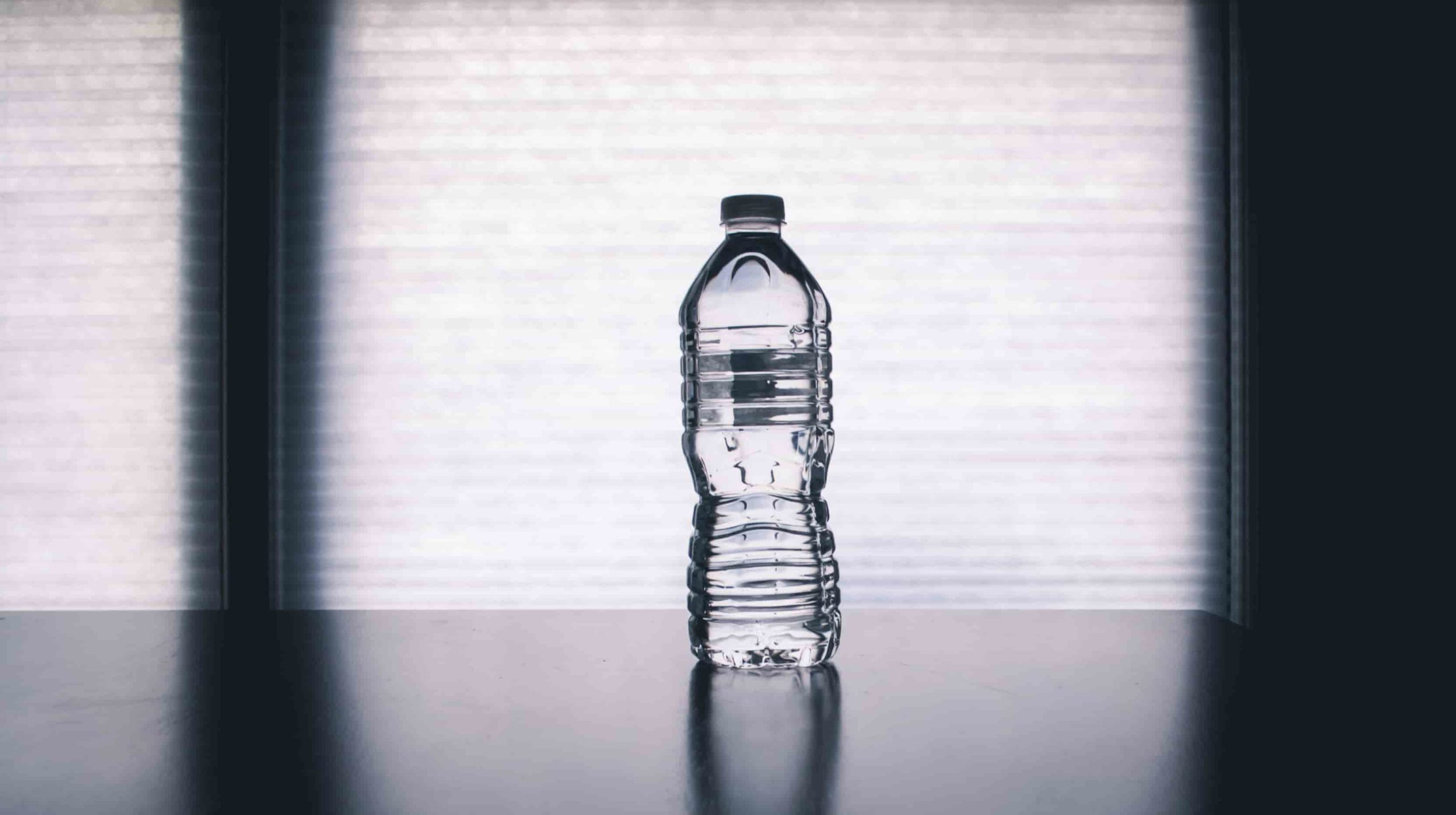 ecobrick plastic bottle on shadowy background