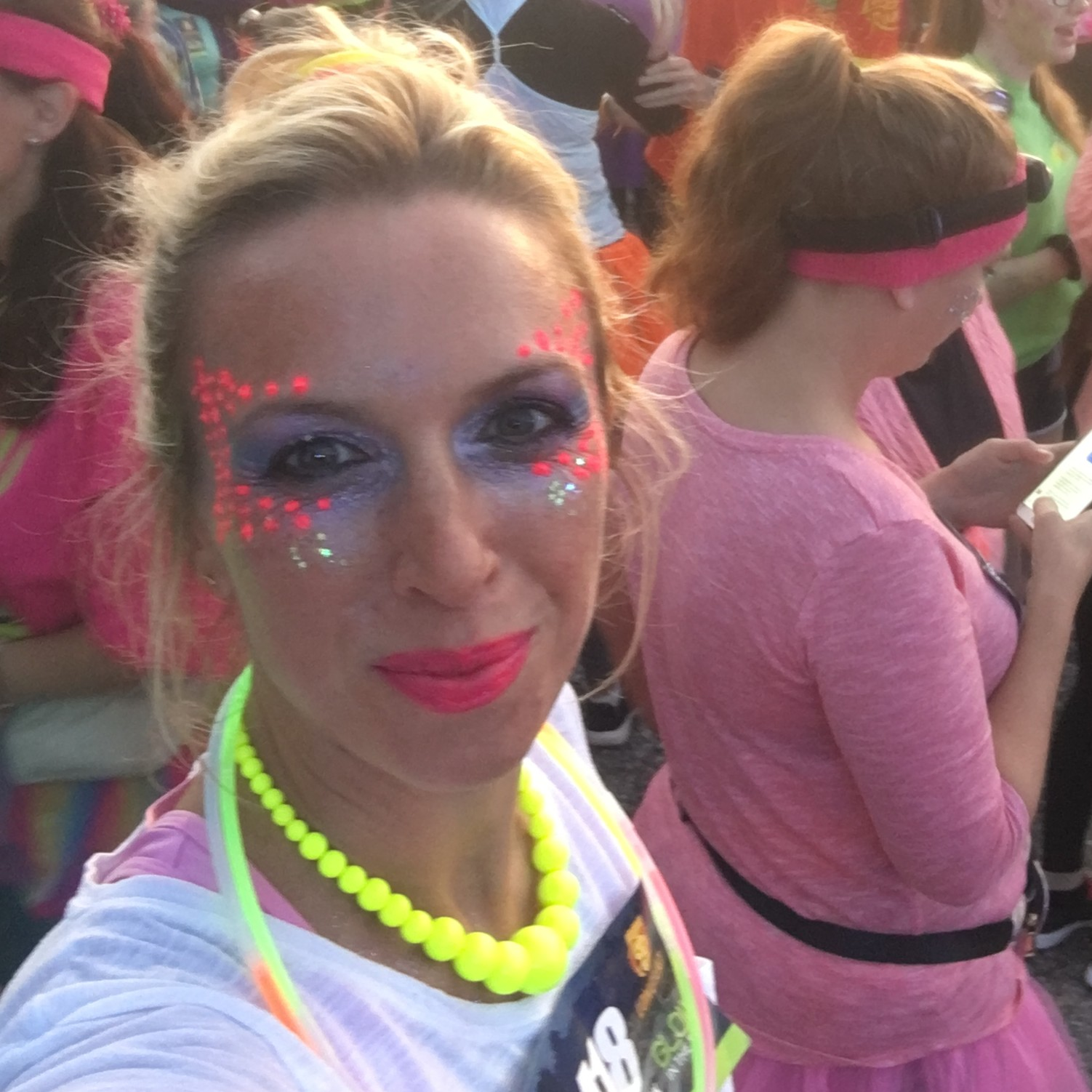 emmie in fluorescent costume at start line of charity event