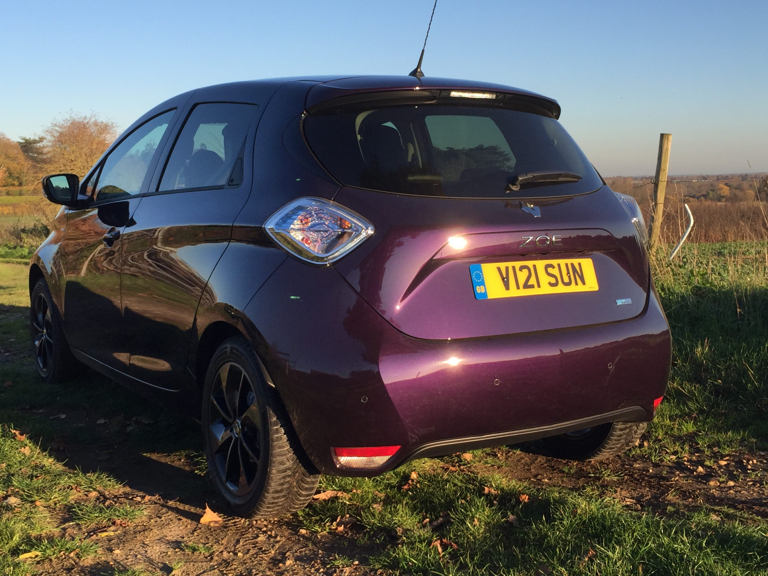 Rear view of Renault Zoe parked in front of a field in the sunshine