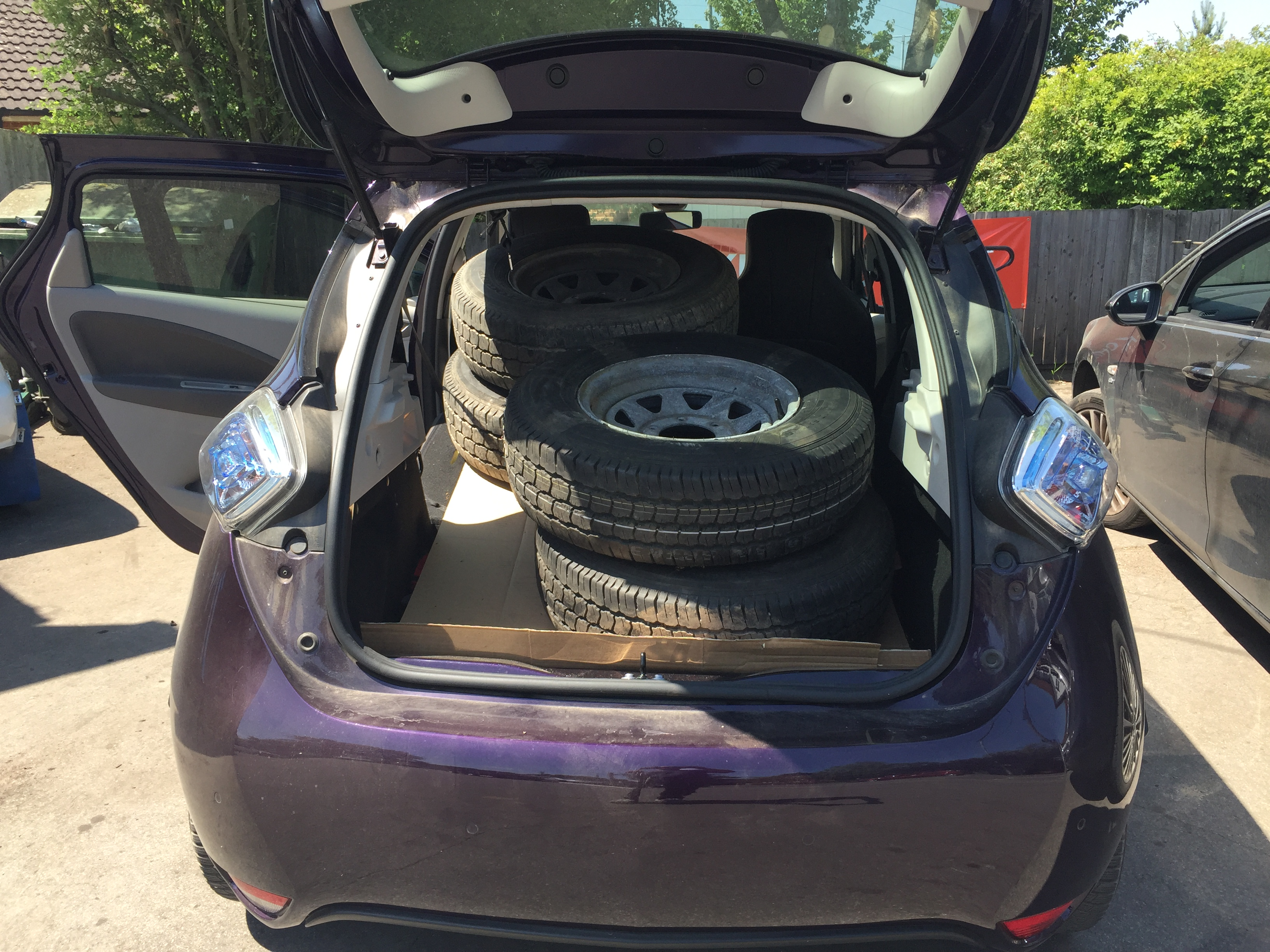 4 land cruiser tyres inside the back of purple Renault Zoe car - life with an electric vehicle