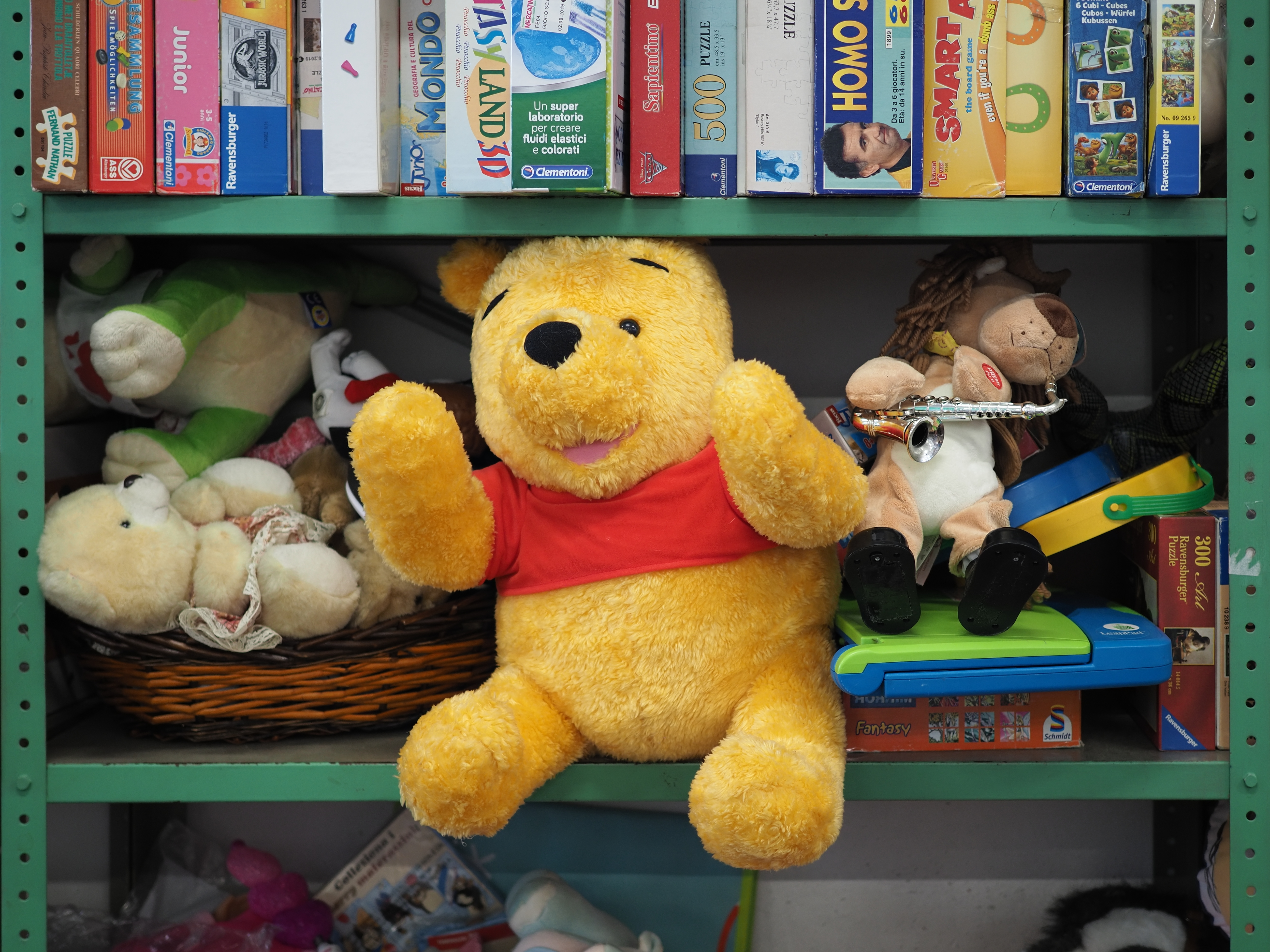 children's toys including a plush Winnie the Pooh on a shelf