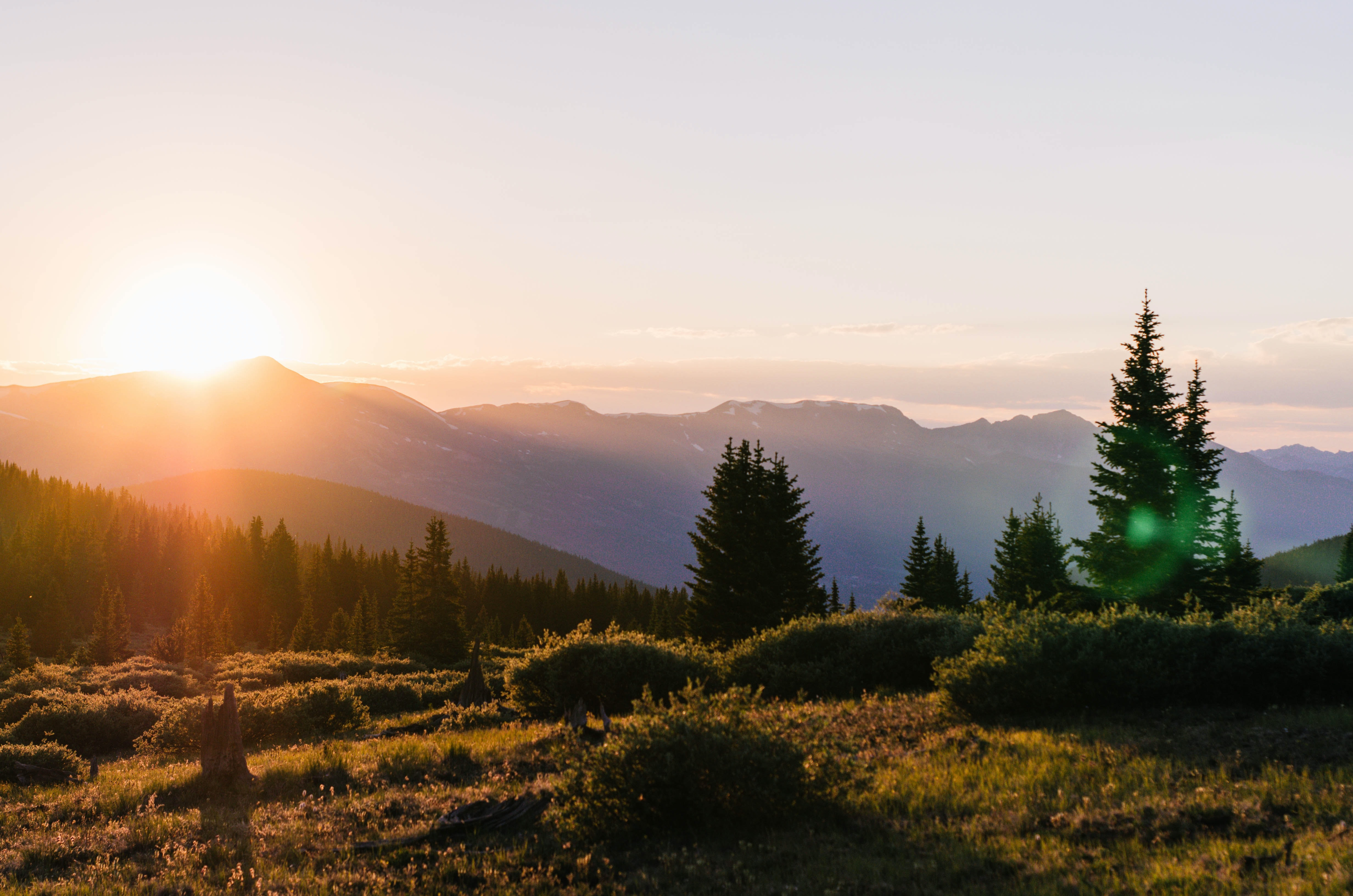 beautiful landscape sunset scene with trees and mountains