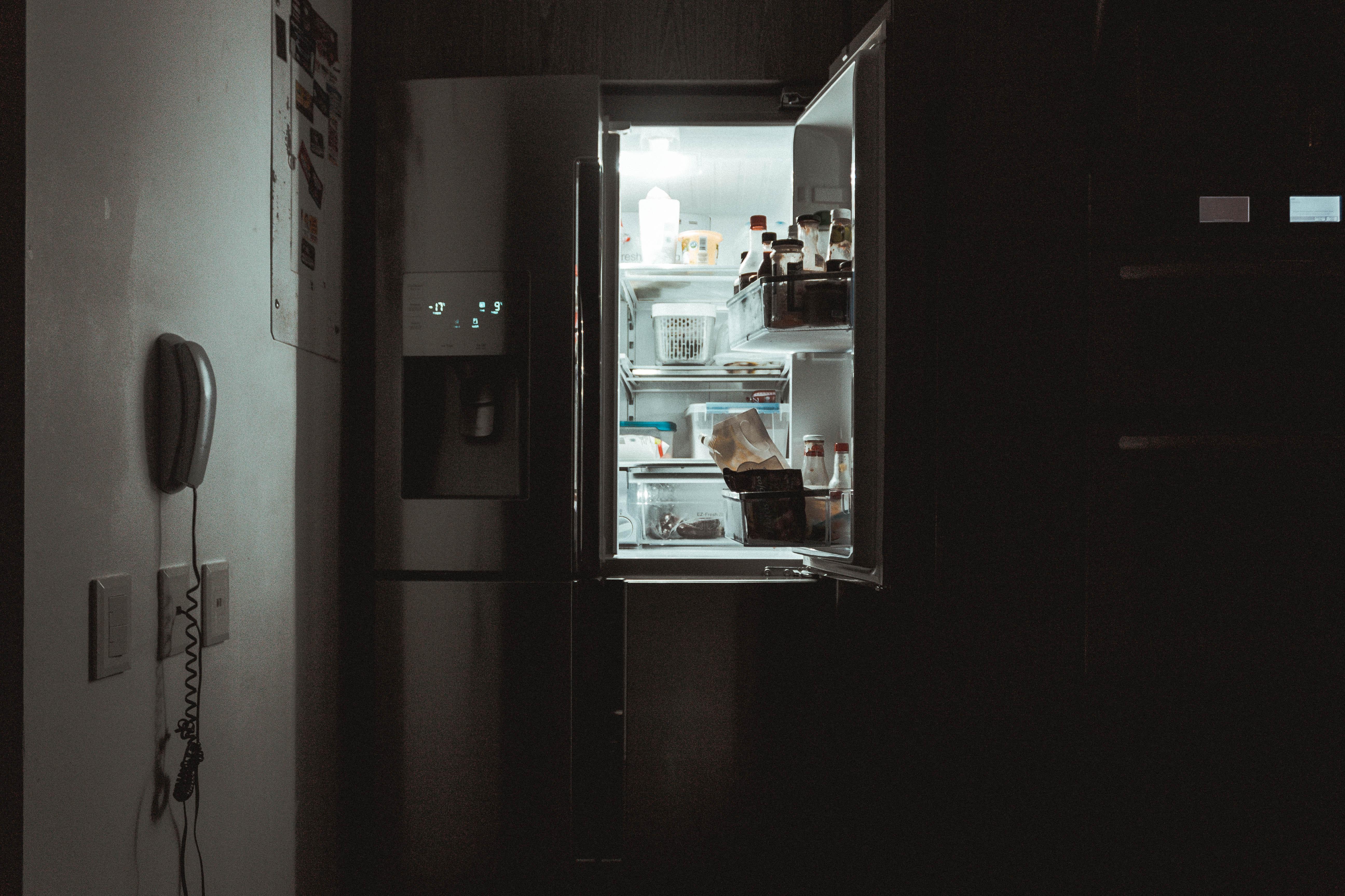 fridge open in the dark