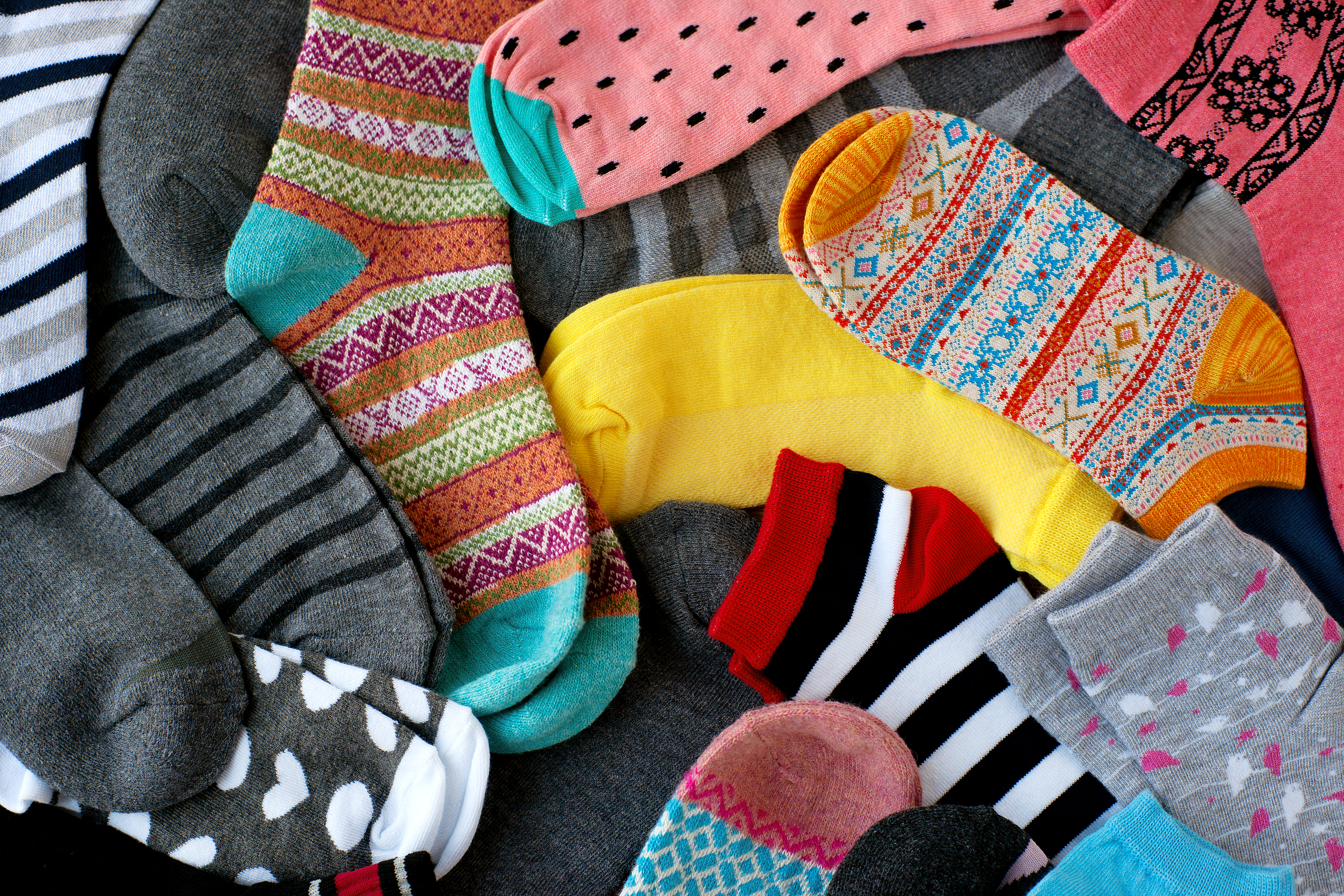 lots of colourful socks laid out