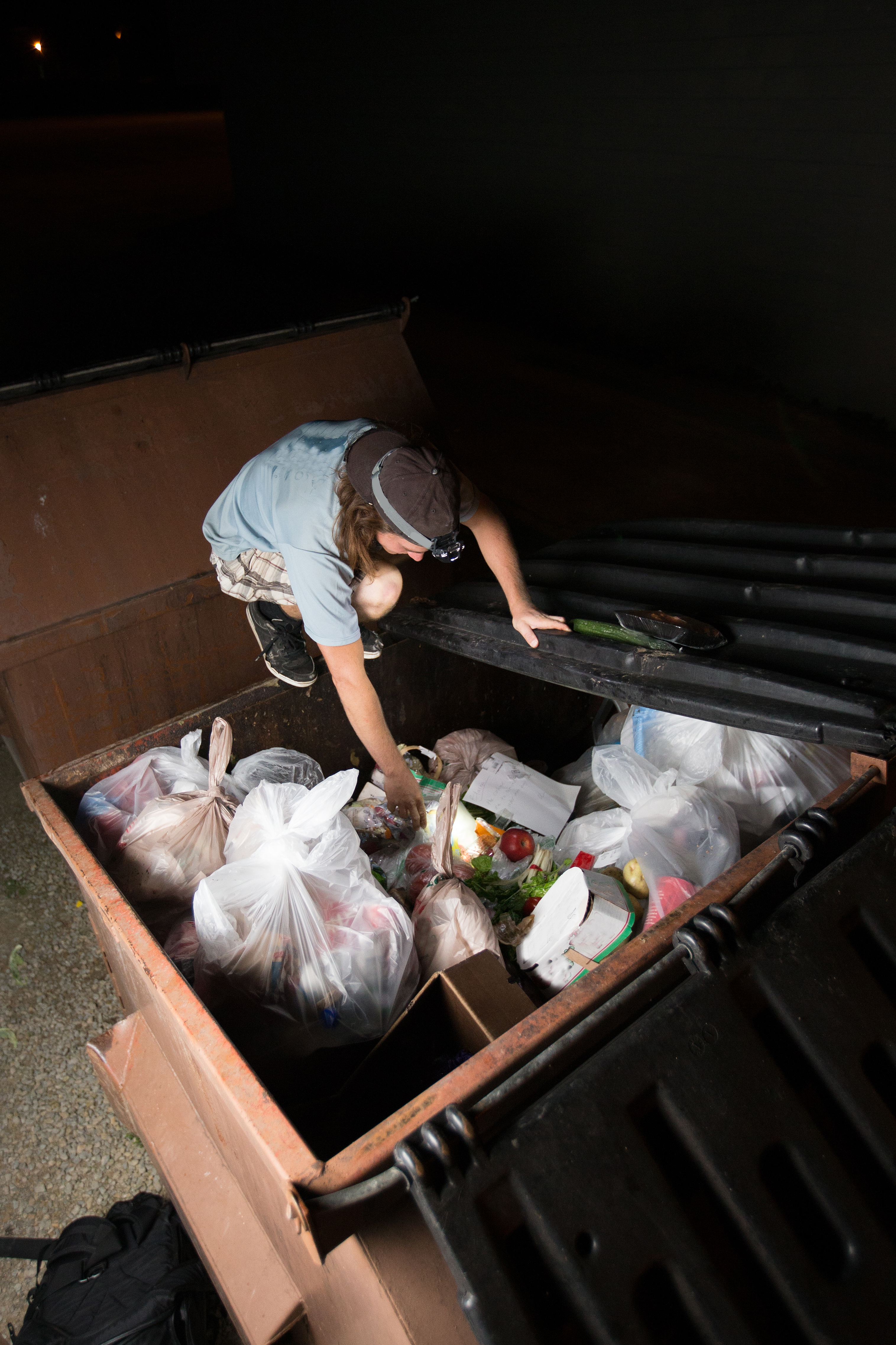 dumpster diving with a headlamp
