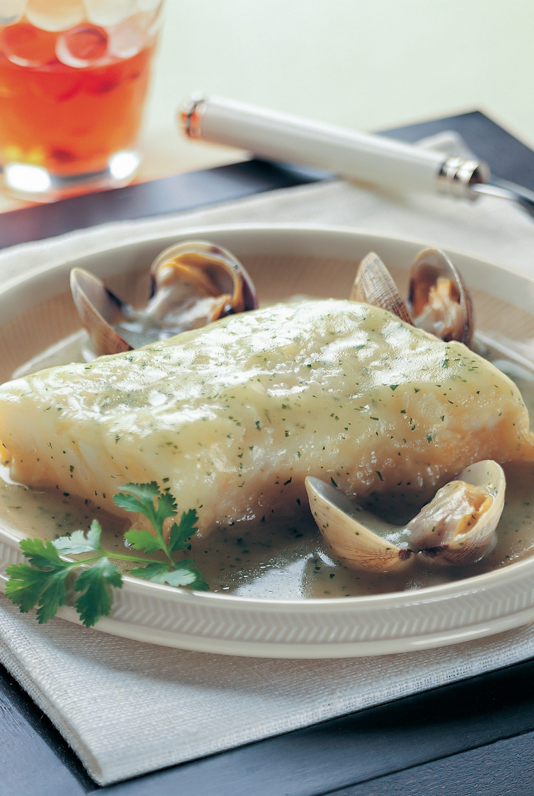 cod and cockles in white wine sauce in season in the uk in April