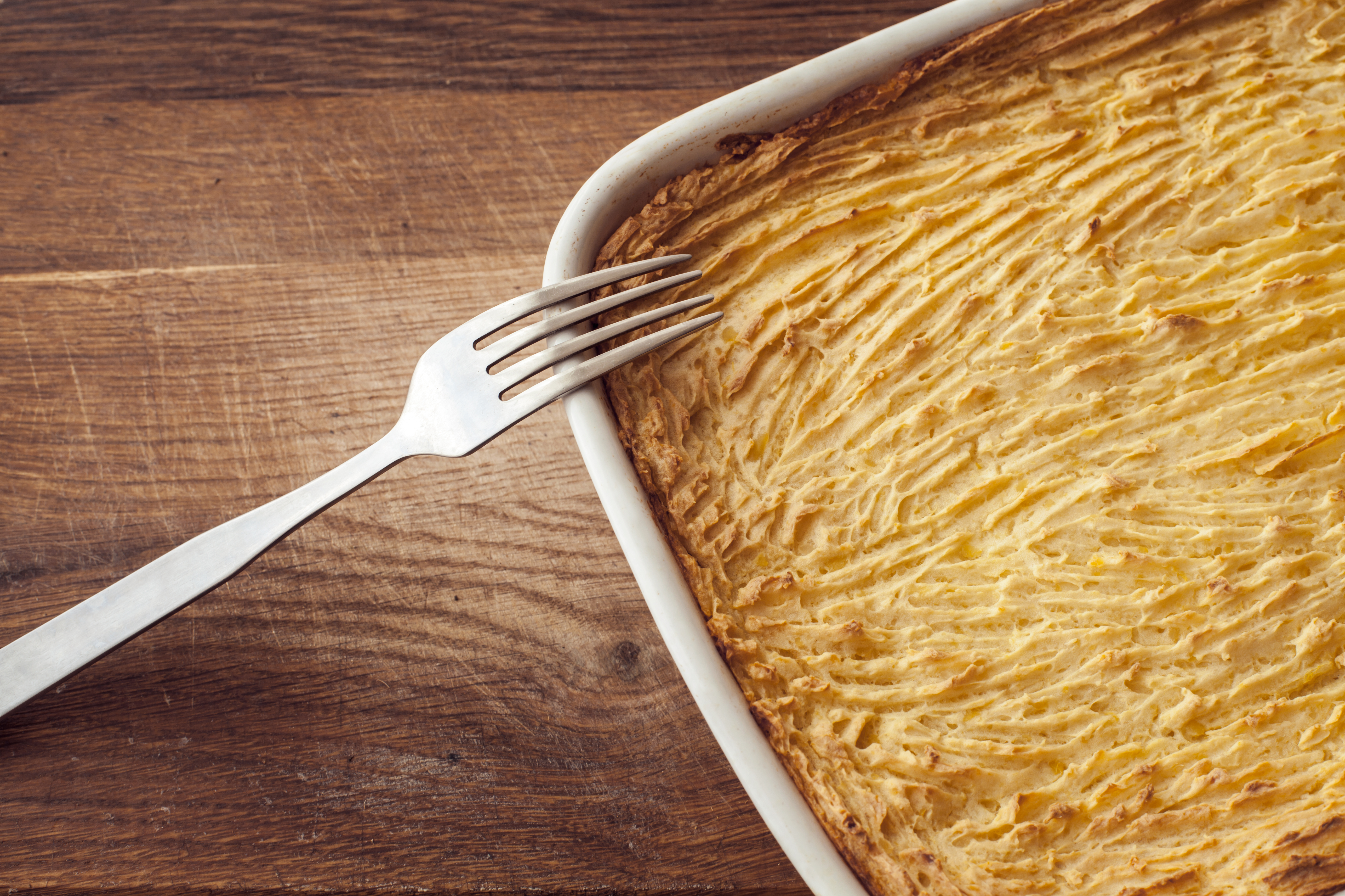 meat-free shepherd's pie with a fork resting on the side of a white dish