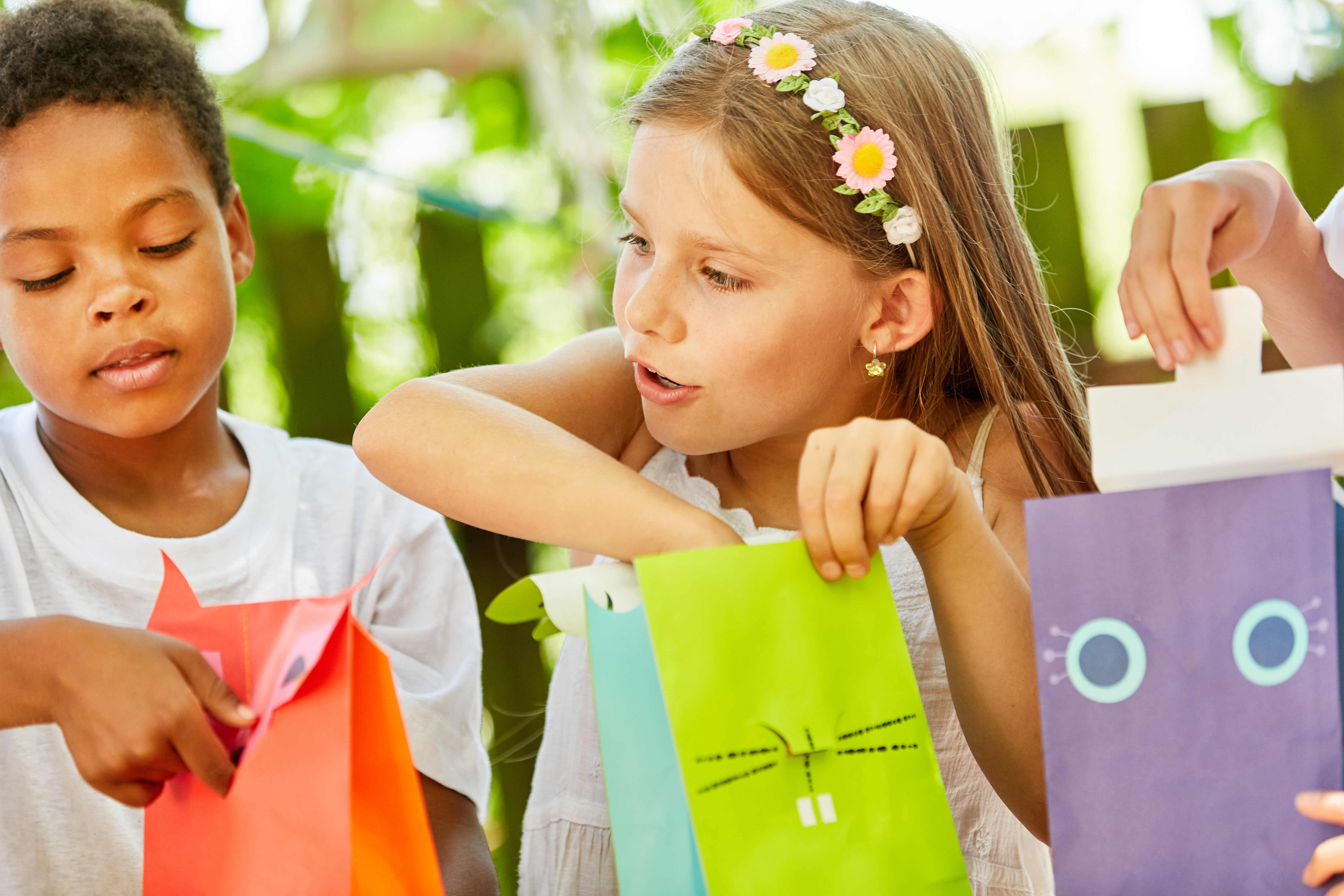 plastic-free party bags with children excitedly opening them
